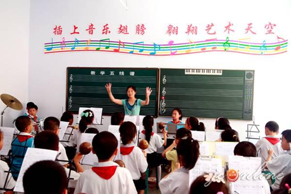 从幼儿园到高中的15年免费义务教育什么时候可以实现?